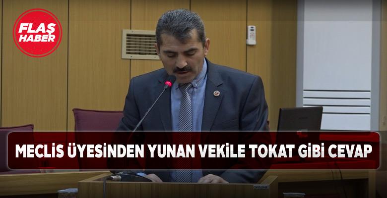 Sivaslı meclis üyesi bayrağımızı yırtan Yunan vekile yüklendi